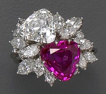 A diamond, pink sapphire and platinum ring