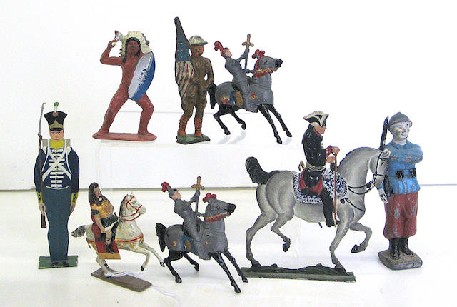 An assembled group of polychrome decorated lead toy soldiers and other figures