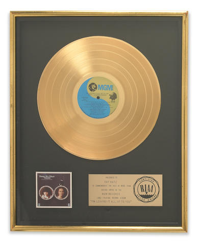A group of gold records presented to Raymond Katz