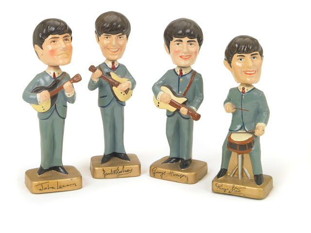 A set of Beatles 'Car Mascot Bobb'n Head' statuettes