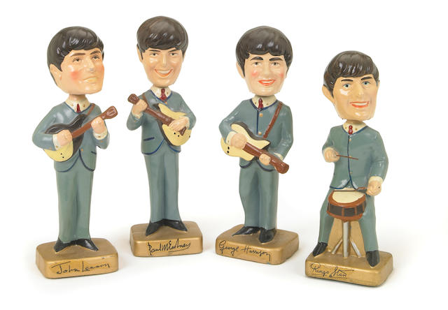 A set of Beatles 'Car Mascot Bobb'n Head' statuettes