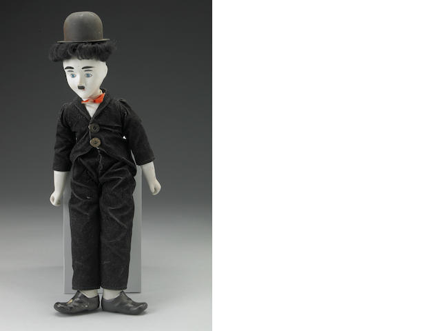 "A Charlie Chaplin porcelain doll relating to the stage production ""Chaplin"""