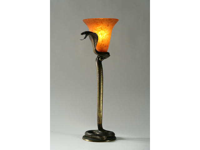 An Edgar Brandt and Daum Nancy gilt-bronze and glass Cobra table lamp