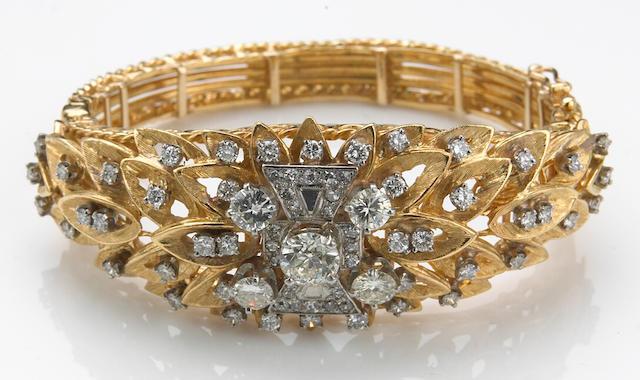 A diamond and eighteen karat bicolor gold bangle bracelet