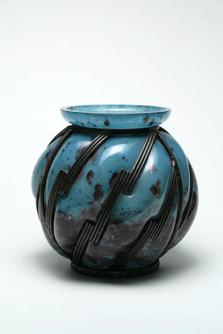 A Daum Nancy wrought-iron mounted reticulated glass vase