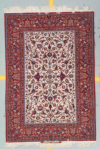 An Isphahan rug size approximately 5ft 1in x 7ft 8in