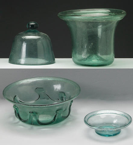 A grouping of aqua blown glass table articles