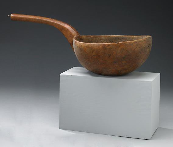 A large burled wood handled ladle