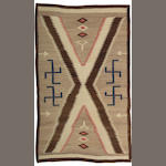 A Navajo rug, 5ft 6in x 3ft 4in