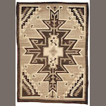 A Navajo Two Grey Hills rug, 5ft 9in x 4ft 1in