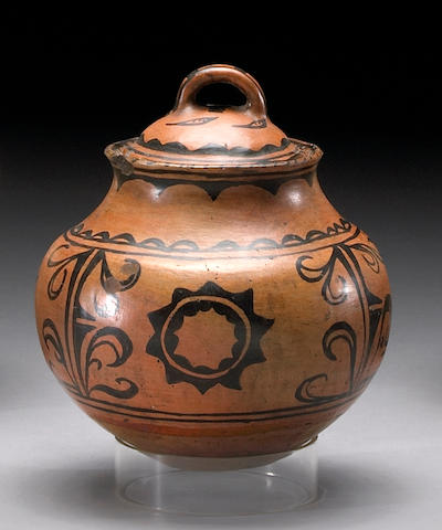 A Tesuque black-on-red lidded jar