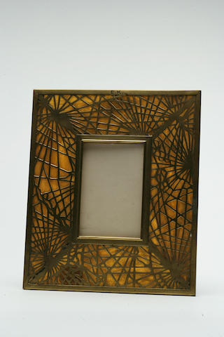 A Tiffany Studios Favrile glass and gilt-bronze picture frame in the Pine Needle pattern