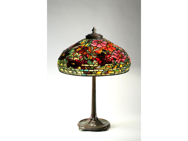 A fine Tiffany Studios Favrile glass and patinated bronze peony lamp