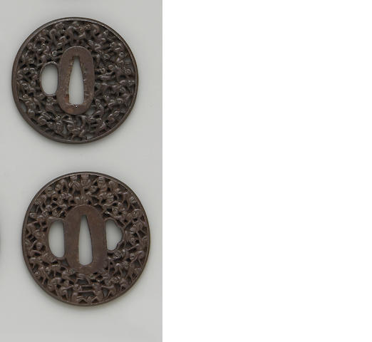 Three reticulated iron Hizen school tsuba Edo Period, 18th Century
