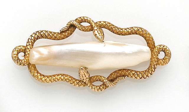 A Victorian river pearl and fourteen karat gold brooch