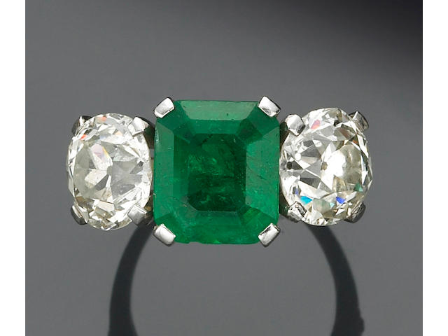 An emerald, diamond and platinum ring