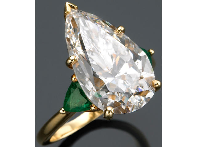 A diamond, emerald and eighteen karat gold ring