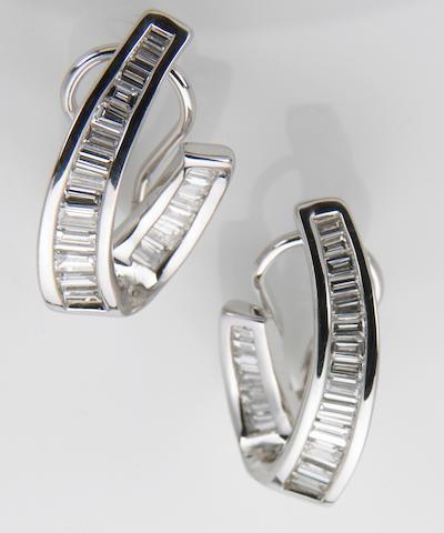 A pair of diamond and eighteen karat white gold earrings