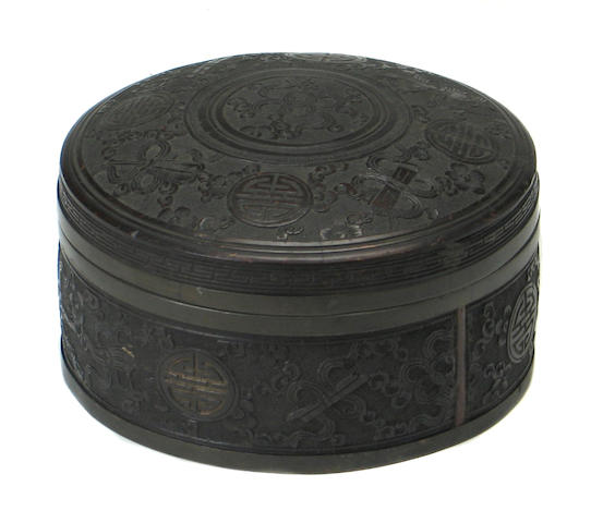 A Chinese wood circular box with cover
