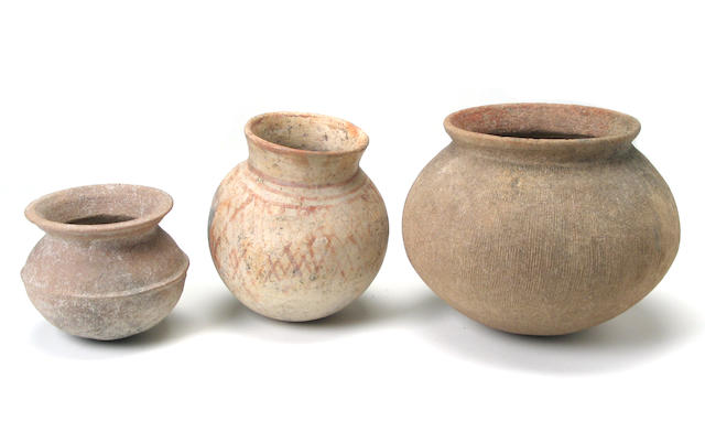 A group of three Asian early style pottery jars