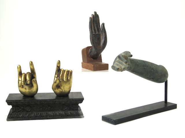 A pair of Chinese gilt bronze hands of a deity