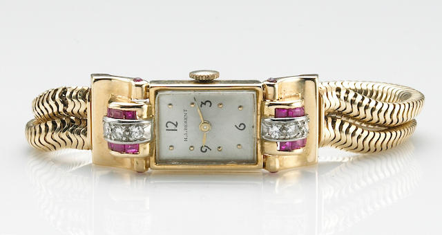H.I.Berent. A 14k pink gold, diamond and synthetic ruby set bracelet watch1950s