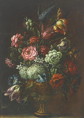 Follower of Andrea Scacciati (Italian, 1642-1710) A still life with roses, tulips and other flowers in a decorated urn; also a companion still life (a pair) 25 x 18in (63.5 x 45.8cm)