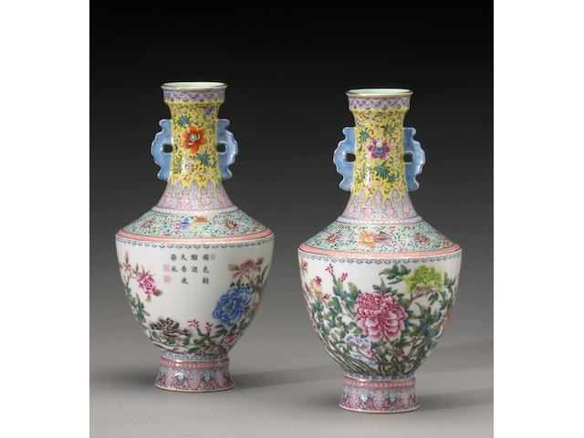 A pair of enameled porcelain vases with floral decoration, four character Qianlong mark