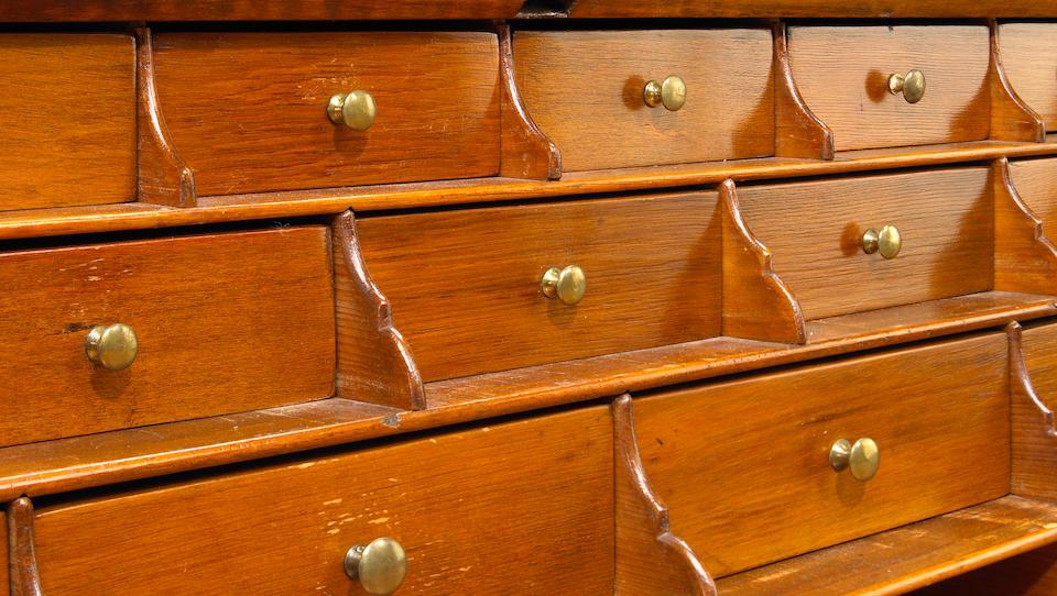 A Chippendale tiger maple slant front desk