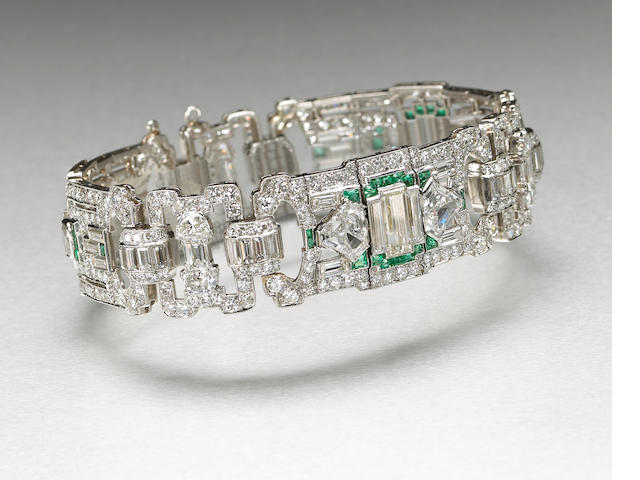 An art deco diamond, emerald and platinum bracelet, 16.50 cts tdw, by Bert H. Satz