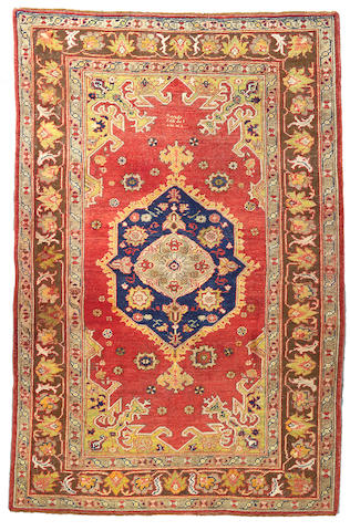 An Oushak carpet West Anatolia size approximately 5ft 4in x 8ft 2in