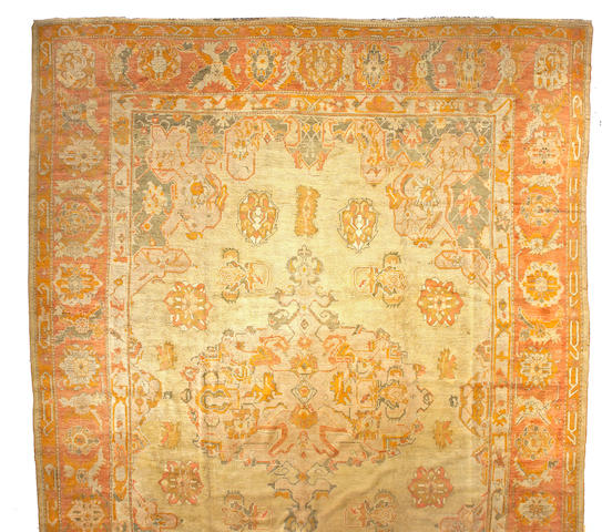 An Oushak carpet West Anatolia size approximately 14ft 5in x 20ft