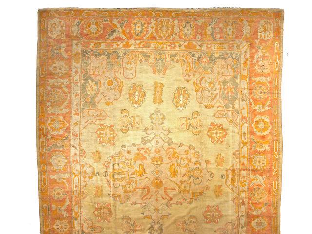 An Oushak carpet West Anatolia size approximately 14ft 5in x 20ft
