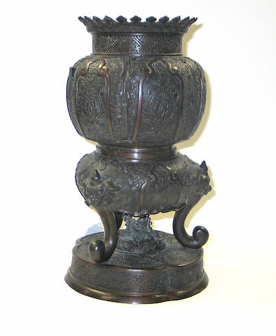 A cast bronze censer