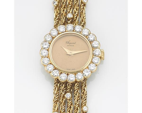 A lady's 18k gold and diamond set bracelet watch, Chopard, Geneve