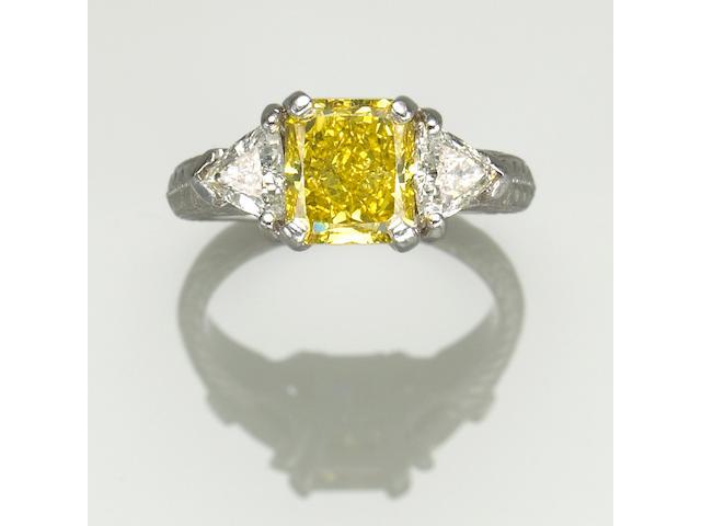A treated yellow, white diamond and platinum ring