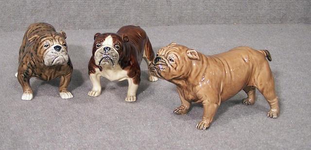 Group of three creamware Bulldogs height 3 1/2 in. (8.9 cm.)