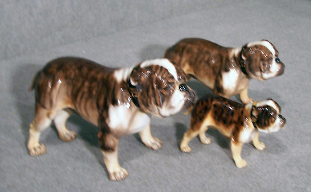 Group of three Royal Doulton brindle Bulldogs height of tallest 5 3/4 in. (14.6 cm.) (3)