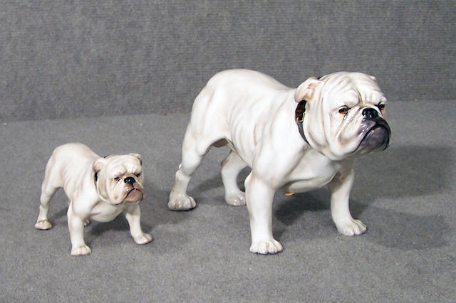 A group of two Royal Doulton white Bulldogs height of largest 5 3/4 in. (14.6 cm.) (2)