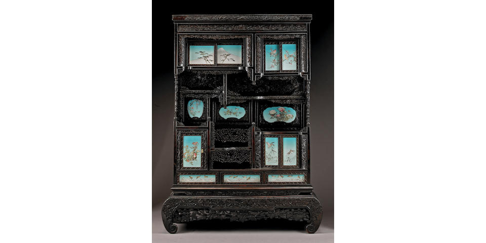 A fine carved and pierced wood shodana inlaid with cloisonne enamel plaques Meiji Period