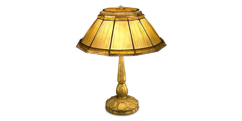 A Tiffany Studios Favrile glass and gilt-bronze linen-fold lamp