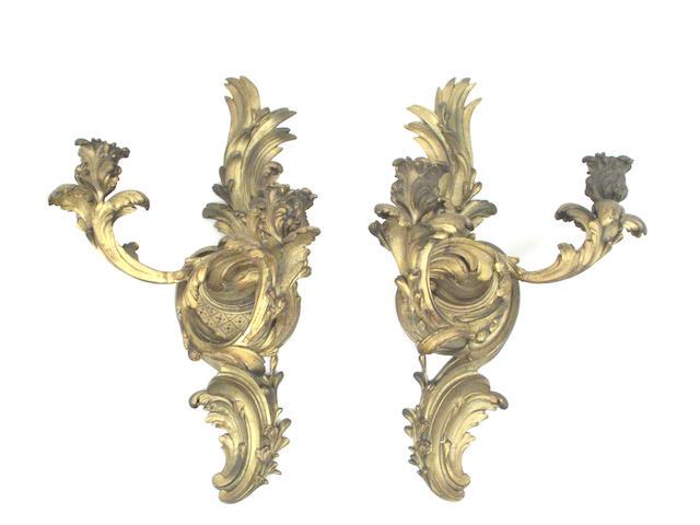 A set of four Louis XV style gilt bronze two light sconces