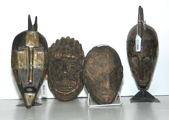 Four West African masks