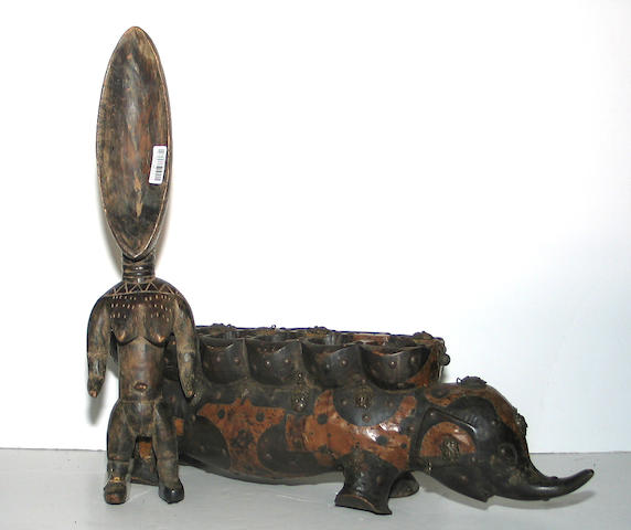 Two West African items: gameboard, spoon