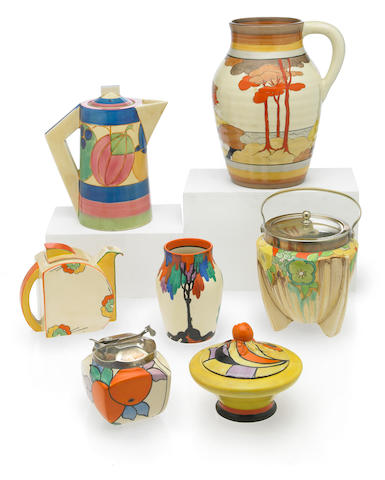 A collection of Clarice Cliff hand painted pottery table articles