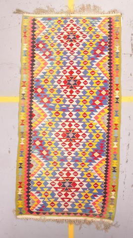 A Turkish Kilim rug size approximately 4ft x 8ft 4in