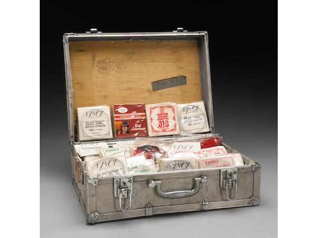 A Jerry Garcia small flight case filled with his spare guitar stings and picks, 1970s-1990s