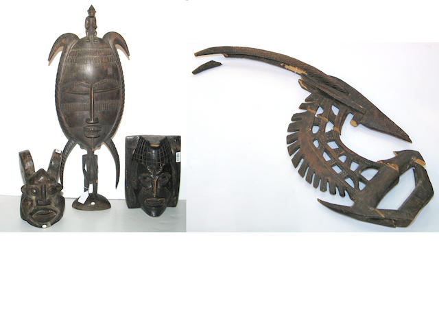 Four African items: masks (2), figure, headdress