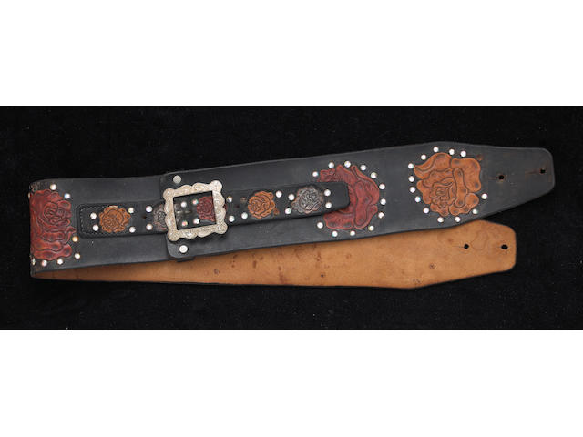 A Jerry Garcia tooled leather guitar strap by Nudie's, worn on stage, 1973