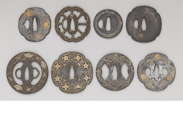 Eight brass inlaid iron tsuba Muromachi to Edo Periods